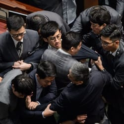 Newly elected lawmaker Baggio Leung is restrained by security after attempting to read out his Legislative Council oath at Legislative Council in Hong Kong on Nov. 2, 2016 (Anthony Wallace—AFP/Getty Images: http://ti.me/2gHNO8V).