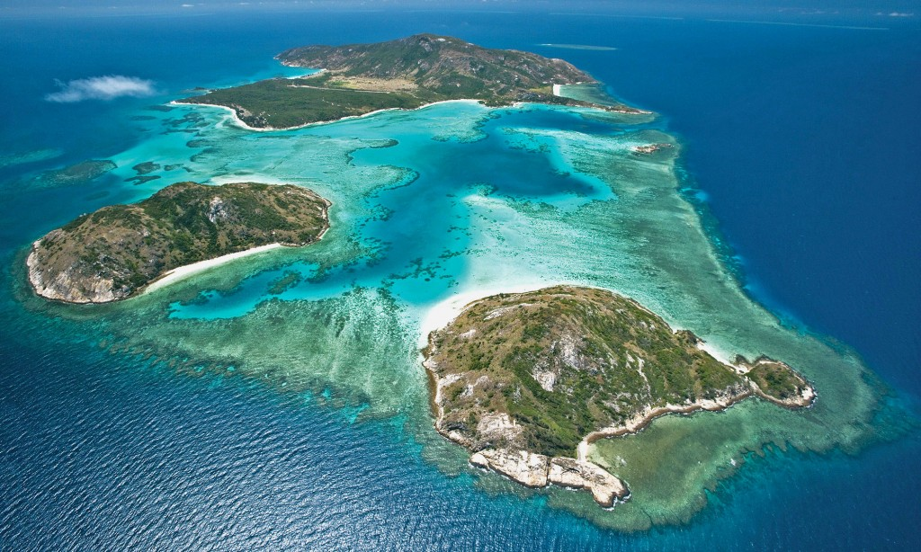 Photograph of Lizard Island. You can see the fringing reef bordering the island from above.