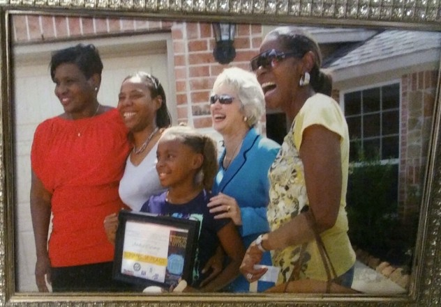 Caraway keeps this framed photo from the day of her signing on her kitchen counter. Left to right: then-City Council Member Wanda Adams, Caraway and her daughter, then-Mayor Annise Parker and Caraway's mother.