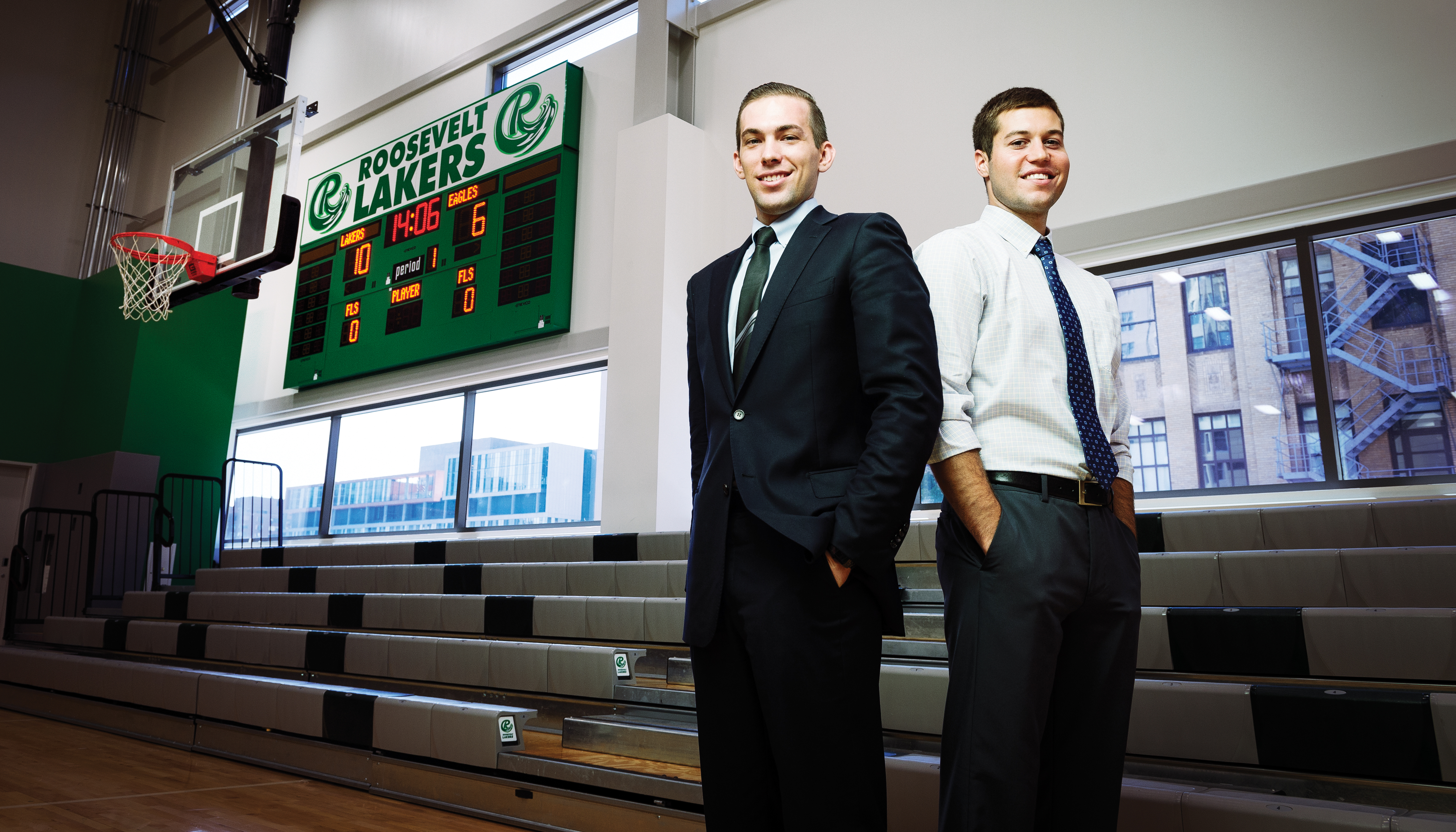 After earning degrees from Roosevelt, former men's basketball teammates Tyler Smith (left) and Mark Tometich are now working in Chicago.
