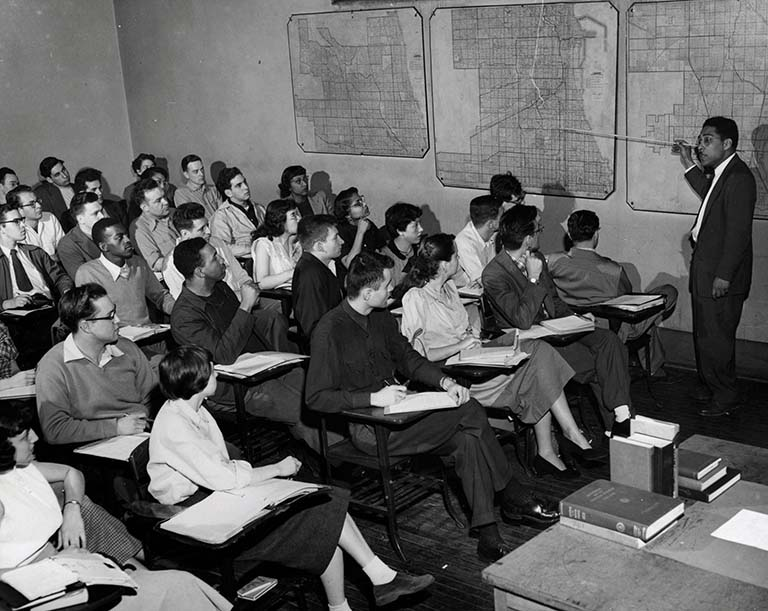 Roosevelt students studied with an outstanding faculty, including the sociologist St. Clair Drake (standing), who co-authored Black Metropolis, the classic study of race and urban lif