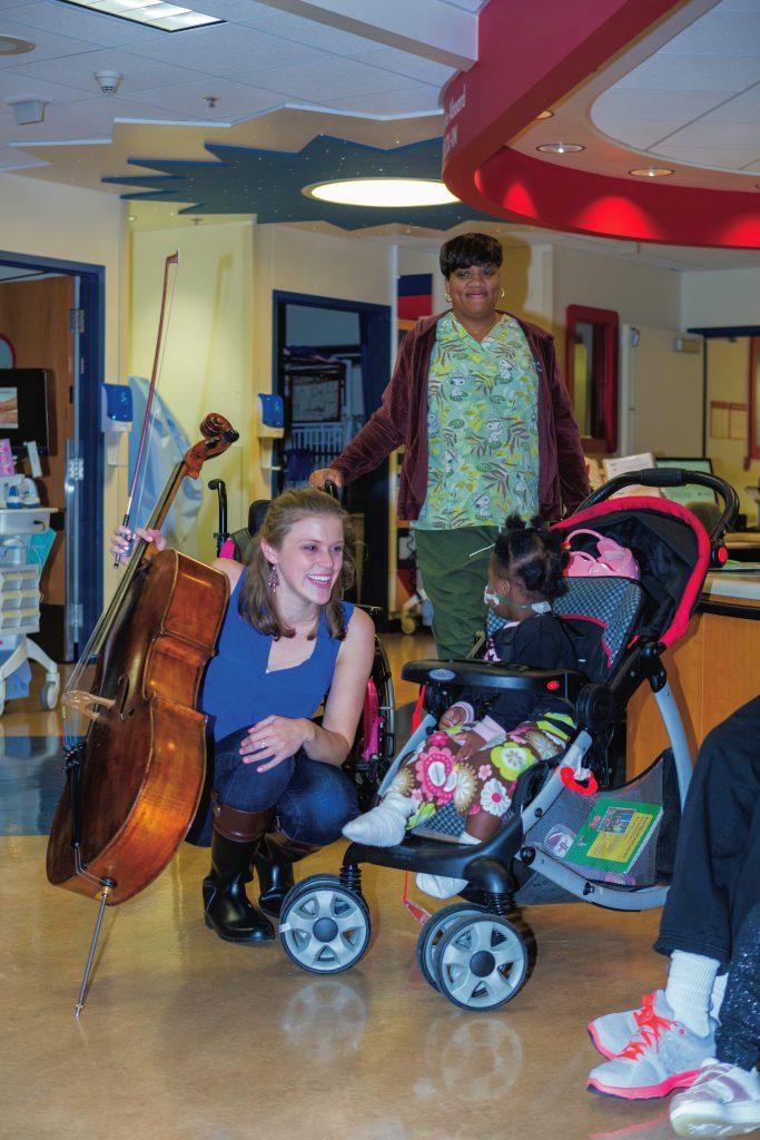 Roosevelt alumna Allegra Montanari greets a youngster at La Rabida Children's Hospital.