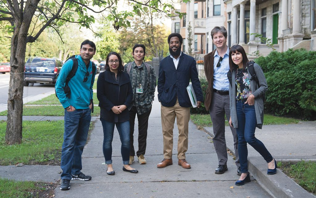 Left, in Chicago's North Lawndale: Roosevelt accounting student Bajesh Punjwani, Mansfield's Lyly Harrington, Roosevelt sociology students Edgar Moreno and Shanti Brown, Roosevelt professor Edward Green and Mansfield's Nancy Michaels.