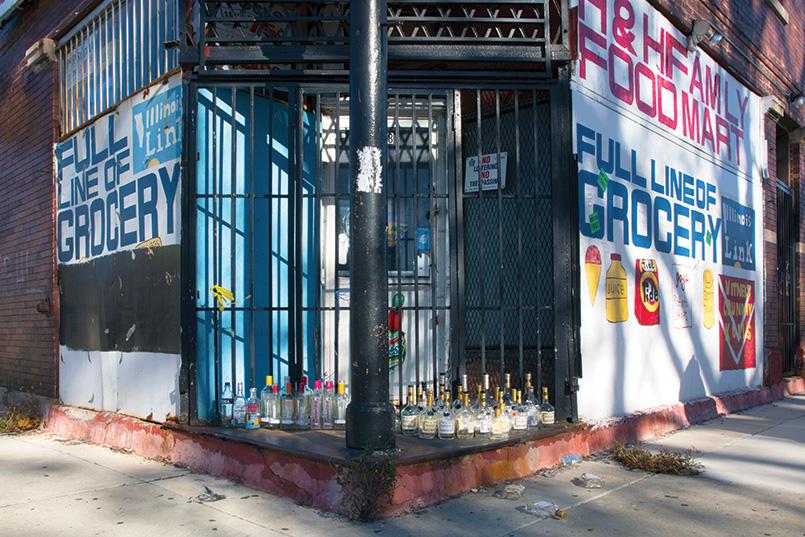 Liquor bottle street memorial.