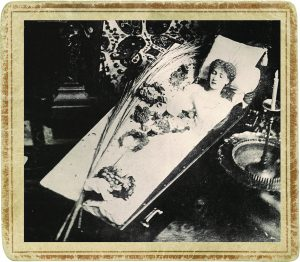 Actress Sarah Bernhardt posing in her traveling coffin.