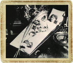 Actress Sarah Bernhardt posing in her traveling coffin.
