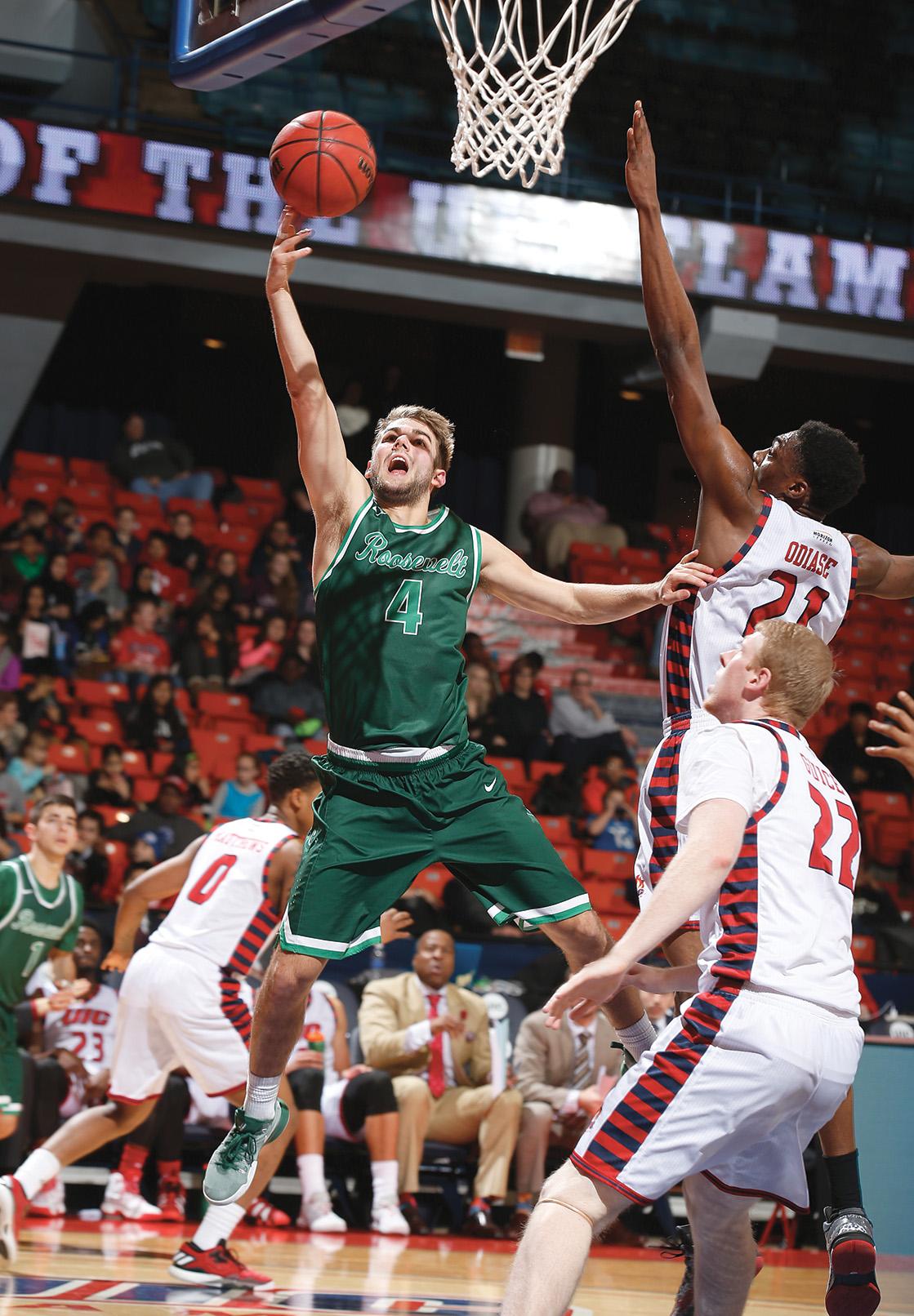 Jake Ludwig playing basketball