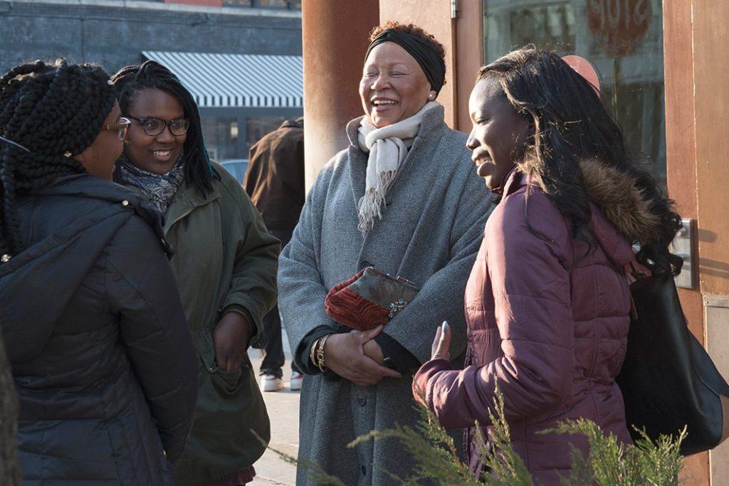 Pat Harris laughs with mentees (left to right) Carlita Kelly, Ta' Tee-Etta McBride and Tierra Jackson.