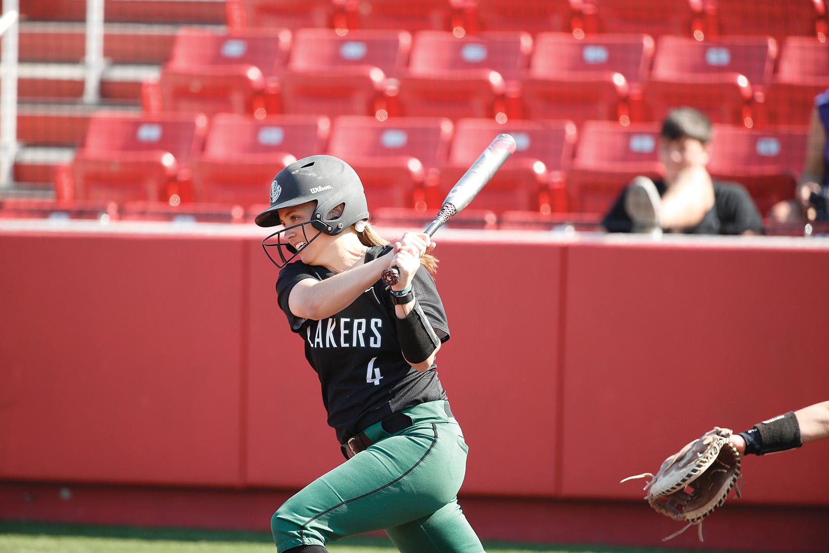 Bethany Hart swinging baseball bat