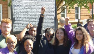 Doria Johnson (center, arm raised) celebrates unveiling of Anthony Crawford marker