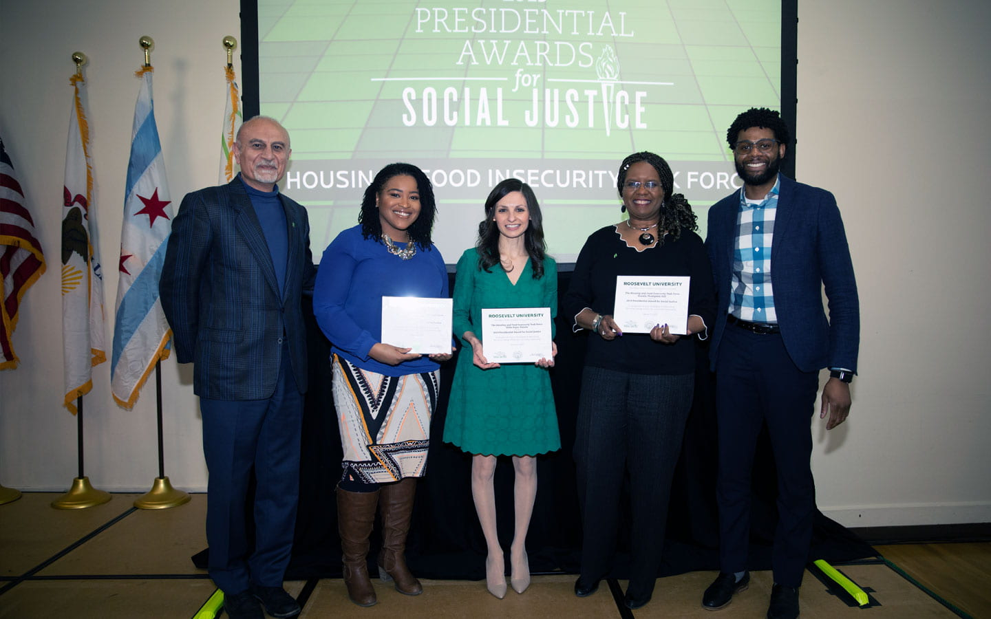 President Ali with award-winning staff members Charity Seaborn, Hilda Rojas-Duarte and Pamela Thompson-Hill.