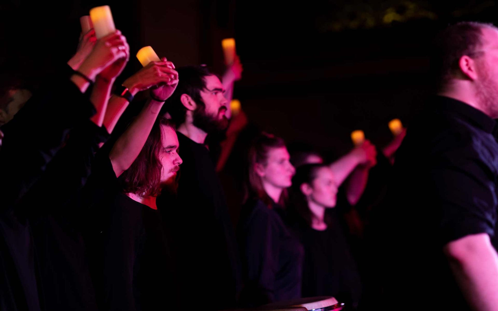 CCPA student performers hold candles during a performance of Considering Matthew Shepard.