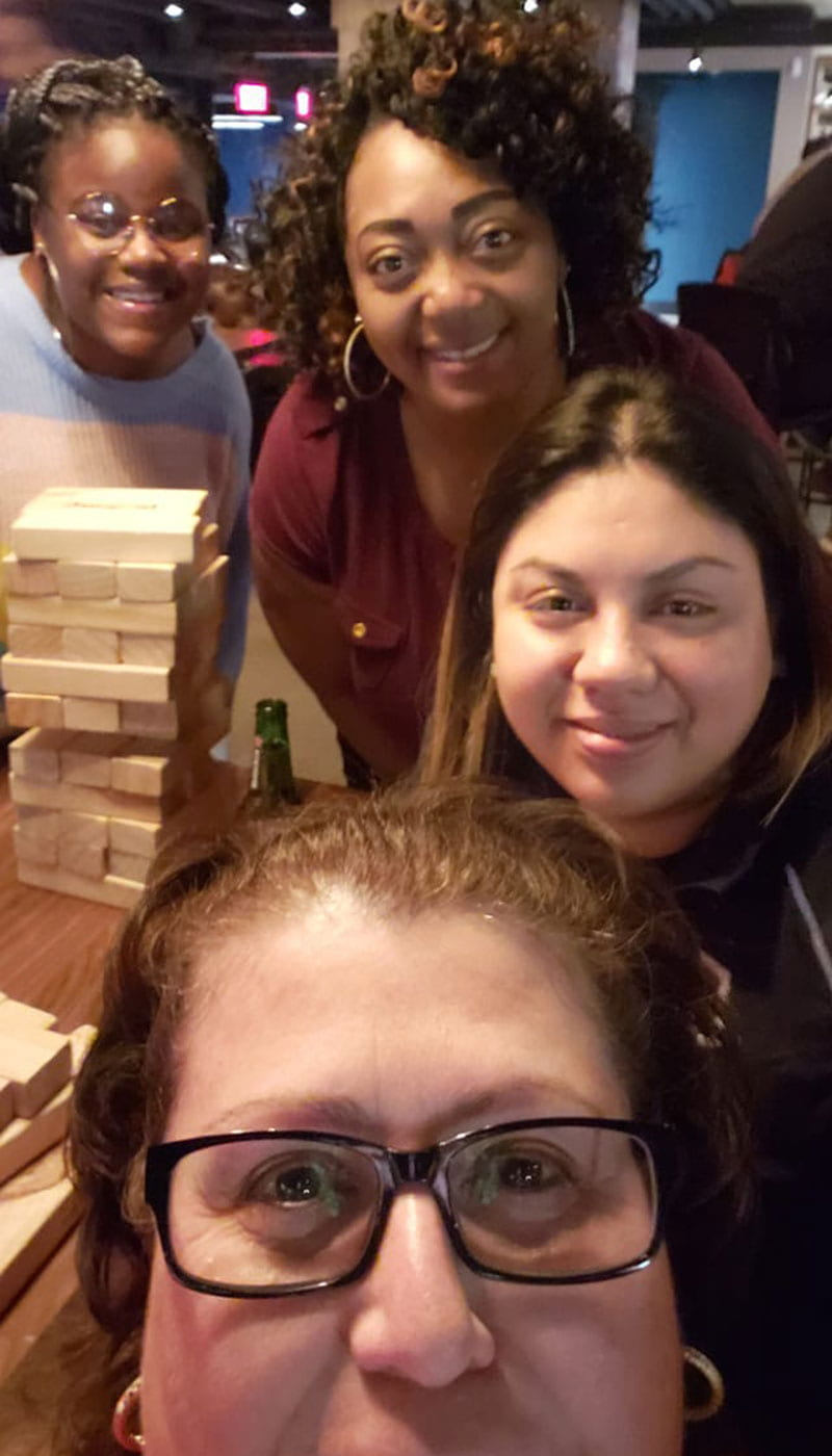 McNair students and staff playing a game of Jenga