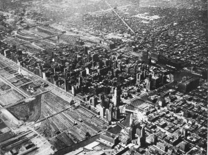 Southwest view of central Chicago in 1936. The complex of railroad lines and industry still constrains the movement of business southward. Chicago Historical Society.