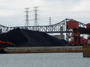 Mounds of petcoke on barges (Photo: Josh Mogerman)