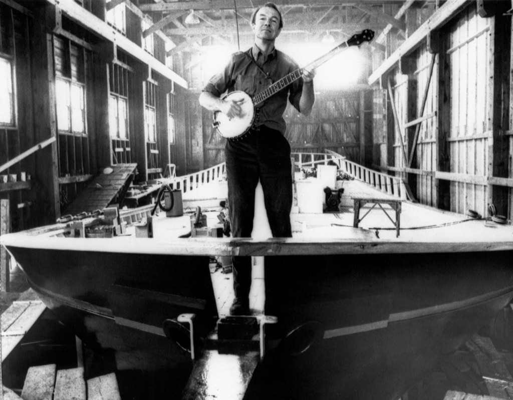 Pete Seeger atop the sloop Clearwater, which he used to promote the environmental cleanup of the Hudson River, along which he lived for many years in Beacon, NY (photo: AP)