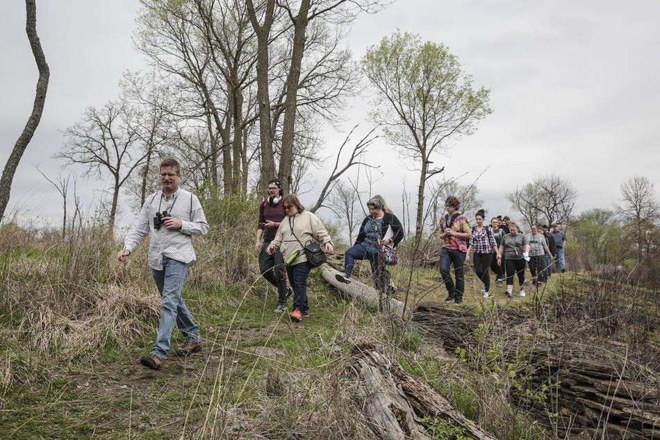 JJC biology prof Andy Neill leads students on an exploration of the campus natural areas, spring 2017 (photo: Eric Ginnard, Joliet Herald-News)
