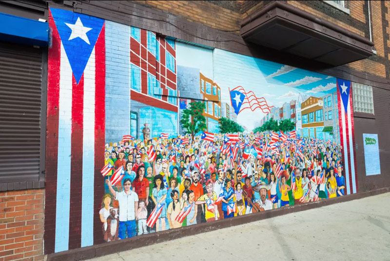 Mural of puerto rican parading and waving Puerto Rico flags