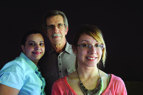 Veronica Jimenez, with her parents, in a photo that ran in the Chicago Sun-Times in May.