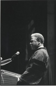 Mayor Harold Washington, class of 1949, addressing Roosevelt University graduates at the January 8, 1984 commencement in the Auditorium Theatre. Photographer: Gary Sigman