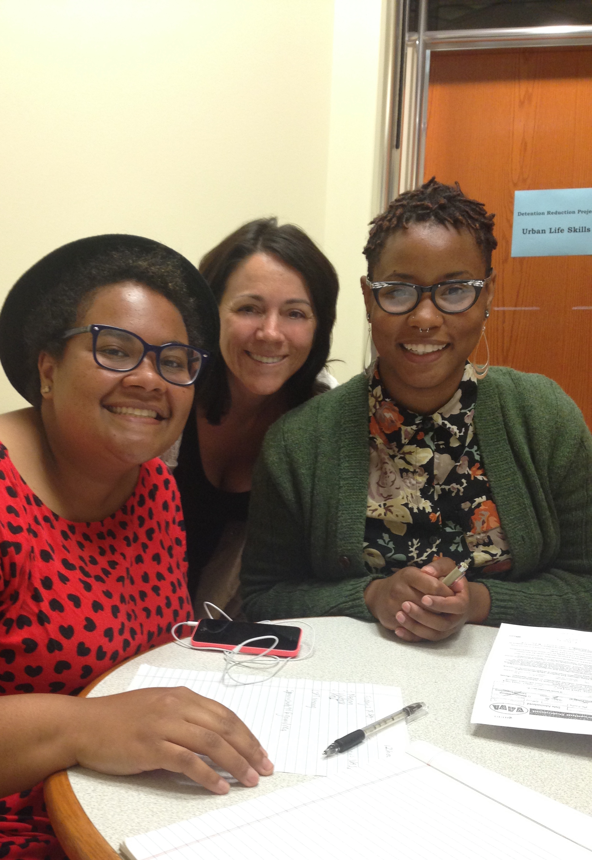 Healther Dalmage (center) with students Jaime Mayer (left) and Symone Simon (right).