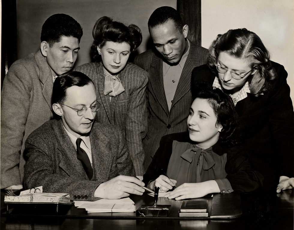 Dr. Wayne A.R. Leys, Dean of Faculties, and the first five students to register at Roosevelt College