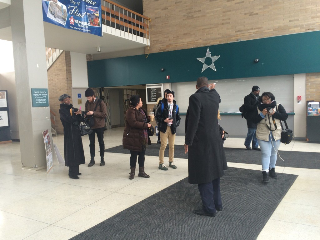 Students taking a tour of Flint City Hall with Councilman Eric Mays.