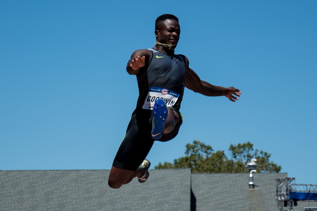 Marquise Goodwin, wide receiver and punt retuner for the Buffalo Bills, soars through the air in the long jump. He finished 12 was was the last qualifier for Sunday's final. Photo by Dillon Vibes
