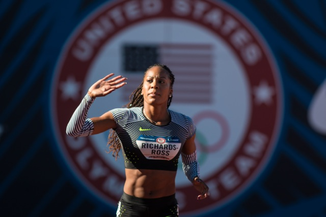 Sanya Richards-Ross waves to the Hayward crowd as she exits the track for the last time. Photo by Dillon Vibes.