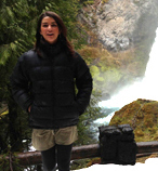 Julia Irizarry hiking in front of a waterfall.