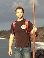 Brian Penserini hiking on the coast.