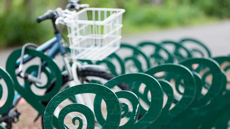 bike parked at green bike rack