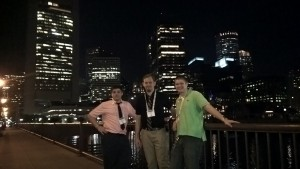 Alex, Ian, and Dan with the Boston evening skyline as the backdrop