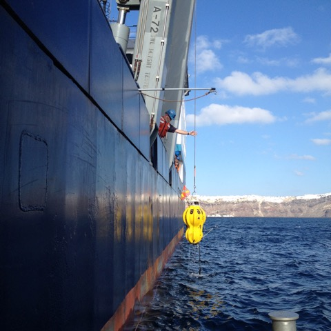 Retrieving an ocean bottom seismometer from the Woods Hole Oceanographic Institution withing Santorini's caldera.