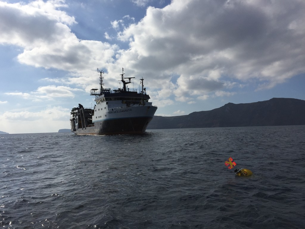 The R/V Marcus Langseth approaching a drifting seismometer in the Santorini caldera.