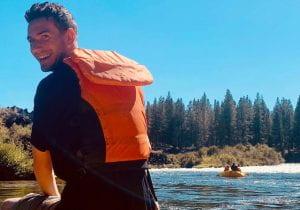 Author wearing a life vest, sitting on a raft