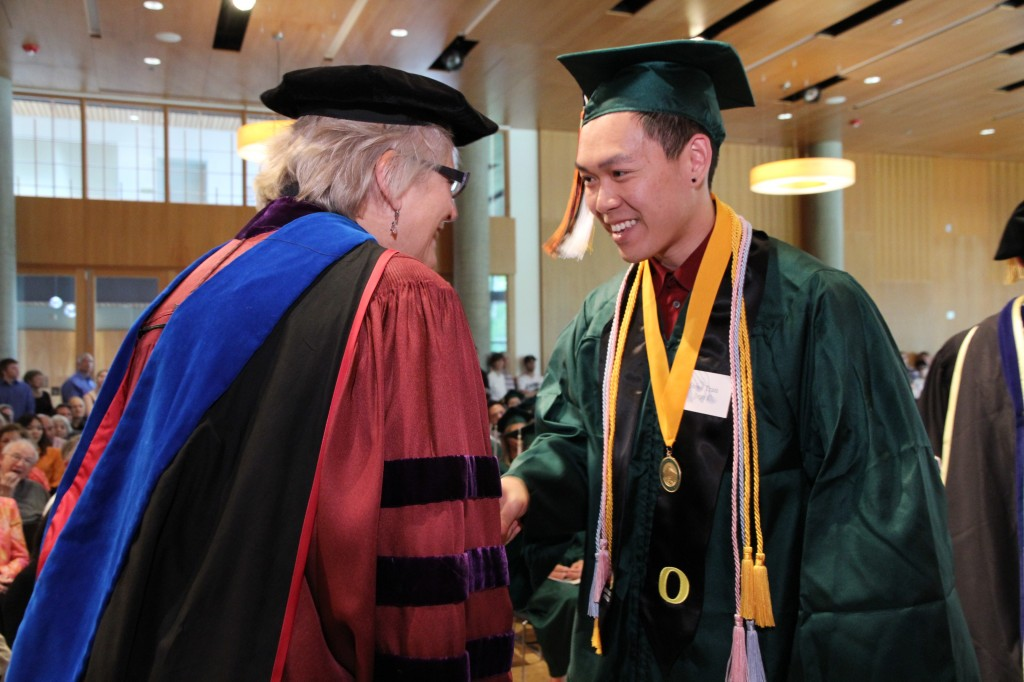 Alpha of Oregon chapter Vice President, Professor Louise Bishop congratulates new member, Steve Tran