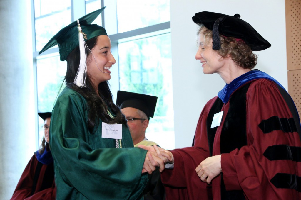 "Phi Beta Kappa Initiate Anzu McMullen received the ""handshake"" from Alpha of Oregon chapter Vice President, Professor Julie Hessler"