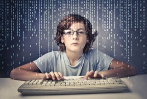 Child using a computer with binary code on the screen