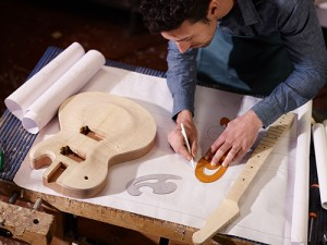 Man making a guitar
