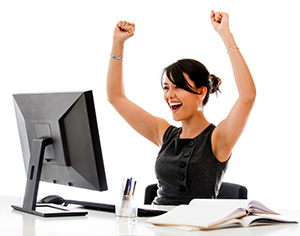 triumphant woman at computer