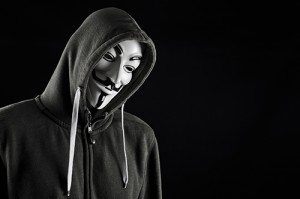 HILVERSUM, NETHERLANDS - MAY 20, 2013: Man wearing Vendetta mask, a well-known symbol for the online hacktivist group Anonymous. Also used by protesters. Editorial use only.