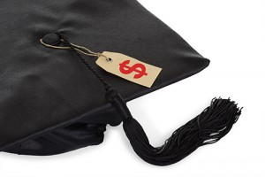 Black graduation cap on white background with price tag attached to tassel.