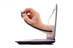 Male hand holding stethoscope emerges from a laptop screen.