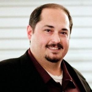 Color photograph of guest blogger Jason James, a 2012 graduate of the UO AIM Program.