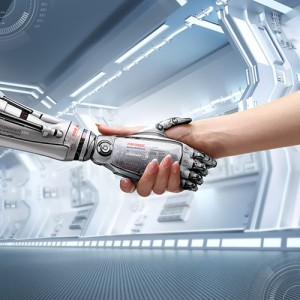 Photograph of a human hand shaking a robot hand in solidarity.
