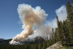 Photograph of smoke from wildfire in the mountains.