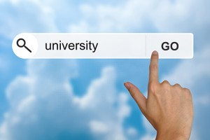 Stock photo of a hand about to click Go when searching with the term University.