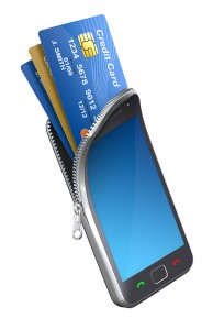 Credit cards emerging from a cell phone.