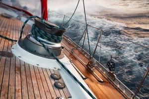Ship sailing through rough seas from perspective of the deck.